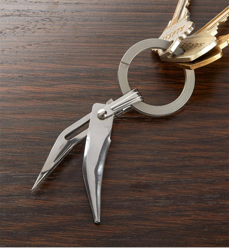 Fold-Out Tweezers attached to a keychain