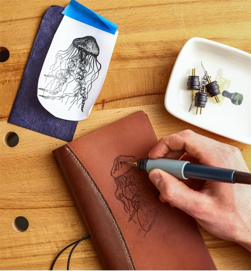 Burning a jellyfish design onto a leather notebook cover