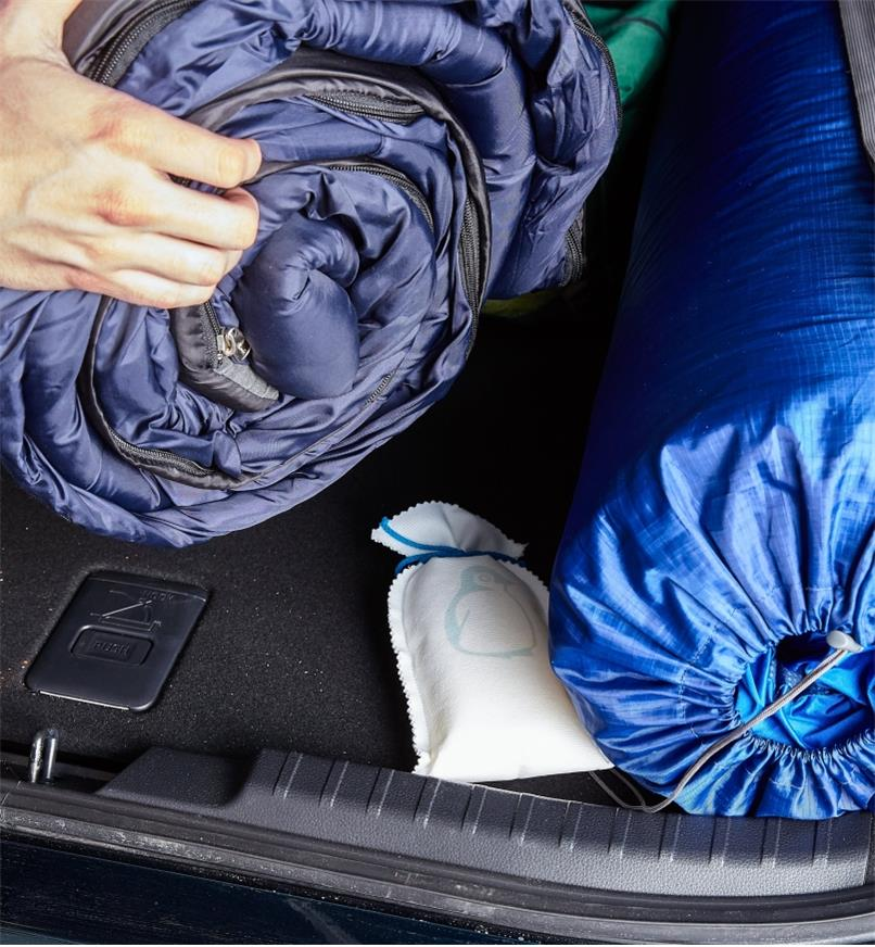 Dehumidifier bag placed in a car trunk under sleeping bags