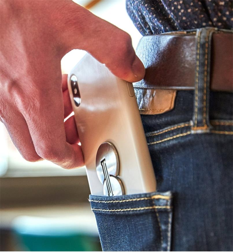 Sliding a phone with a Nite Ize FlipOut Handle & Stand attached into a jeans pocket
