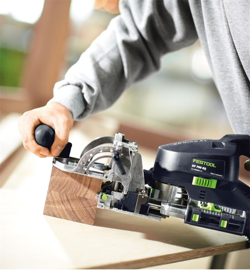 Placing the joiner on a board prior to making a cut