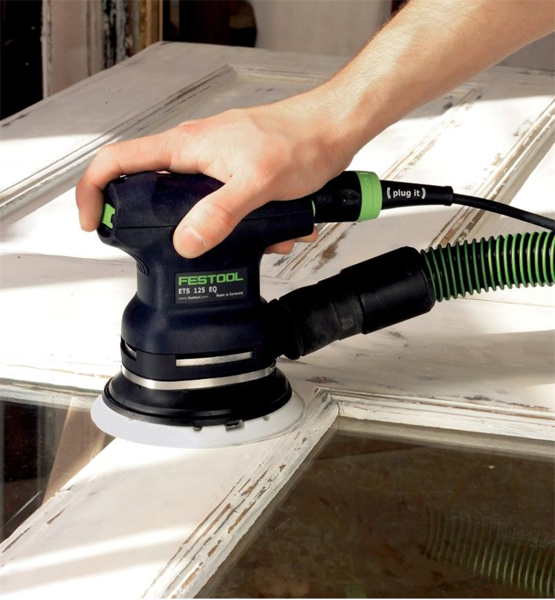 Sanding a painted door with the ETS 125 REQ Random Orbital Sander