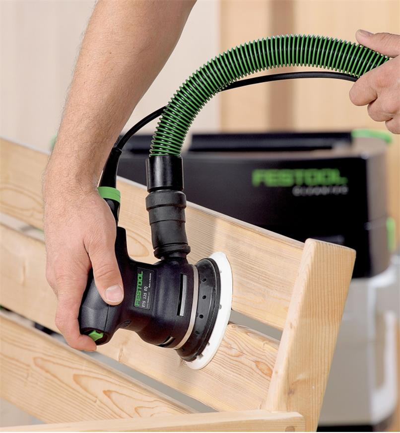 Sanding a wooden bench with the ETS 125 REQ Random Orbital Sander