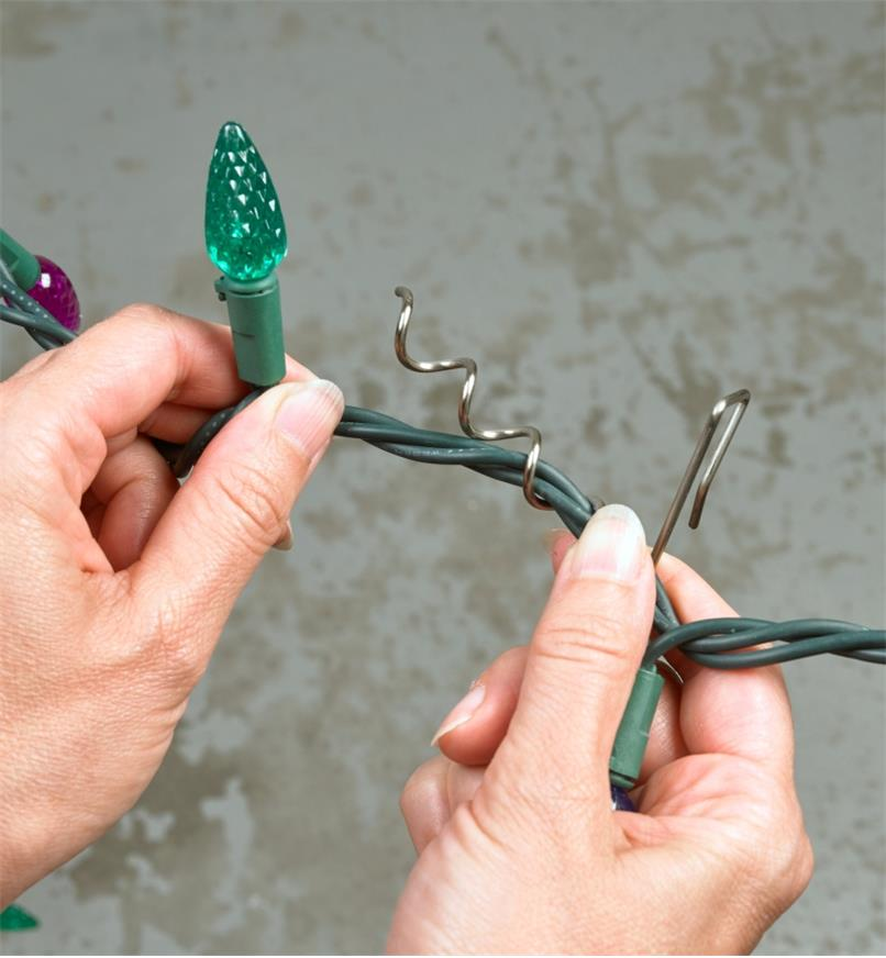 Winding a Christmas lights wire into the corkscrew portion of a hanger