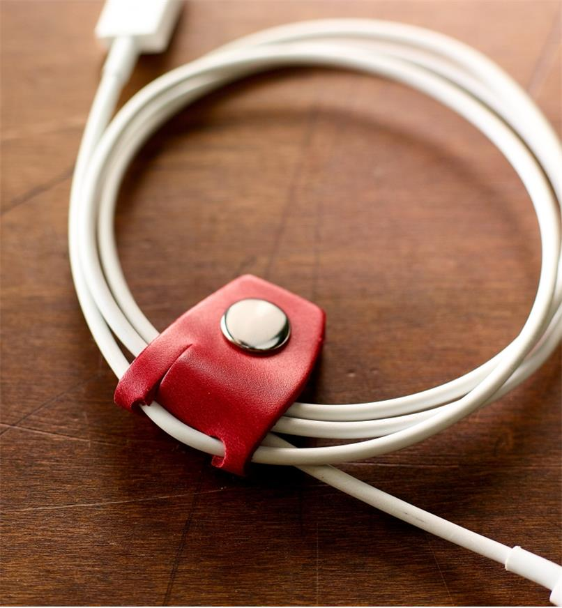 Close-up of Leather Cord Keeper holding a bundled cord