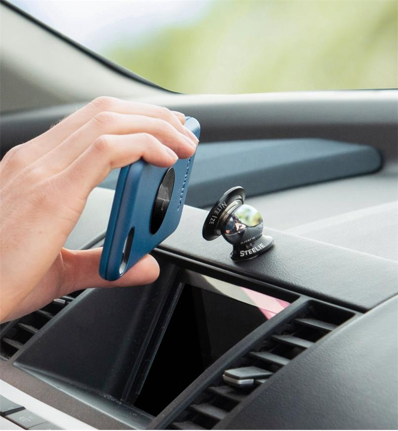Attaching a cell phone to a dashboard-mount kit installed on a car dashboard