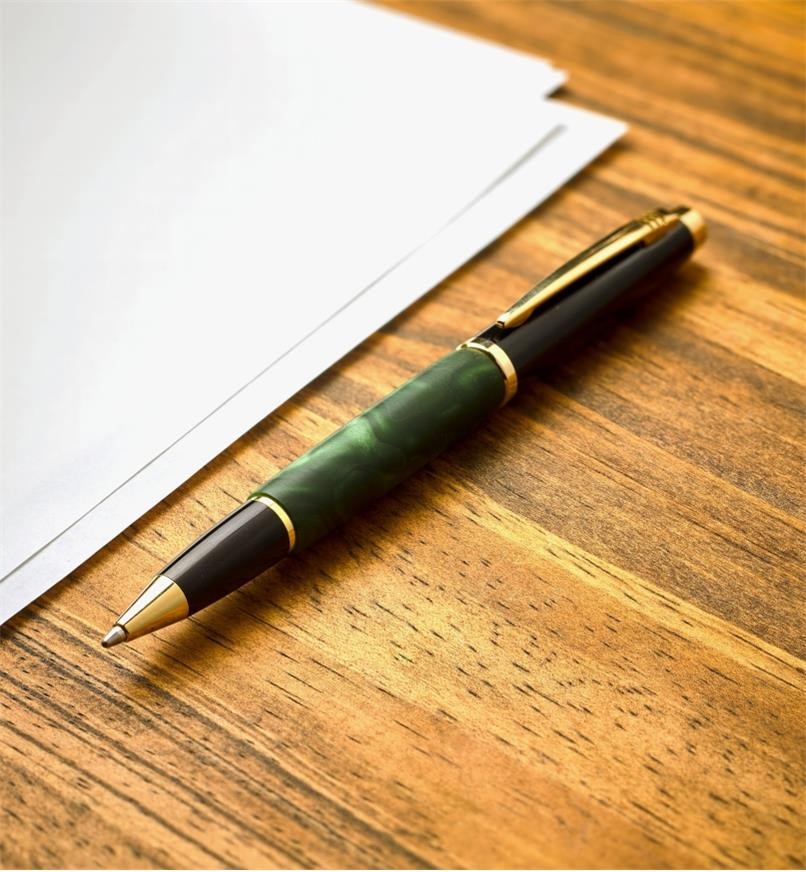 Example of a Geta gold pen turned from a green acrylic acetate blank