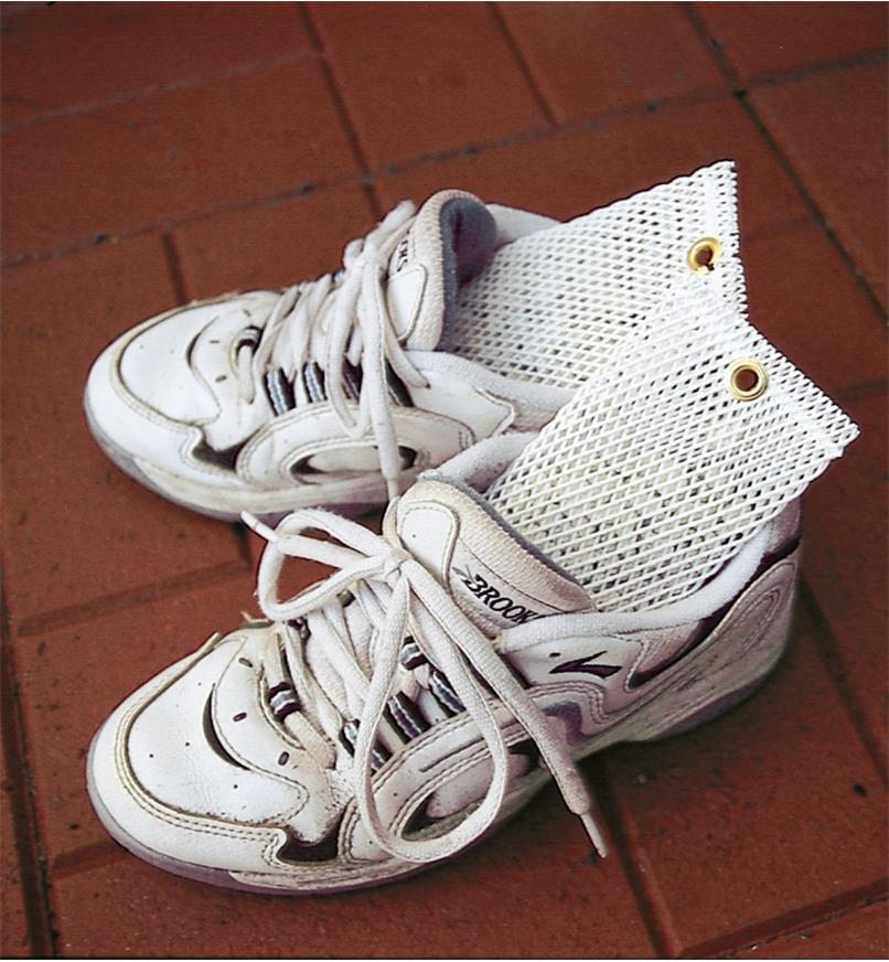 4 oz Deodorizers inserted in a pair of sneakers