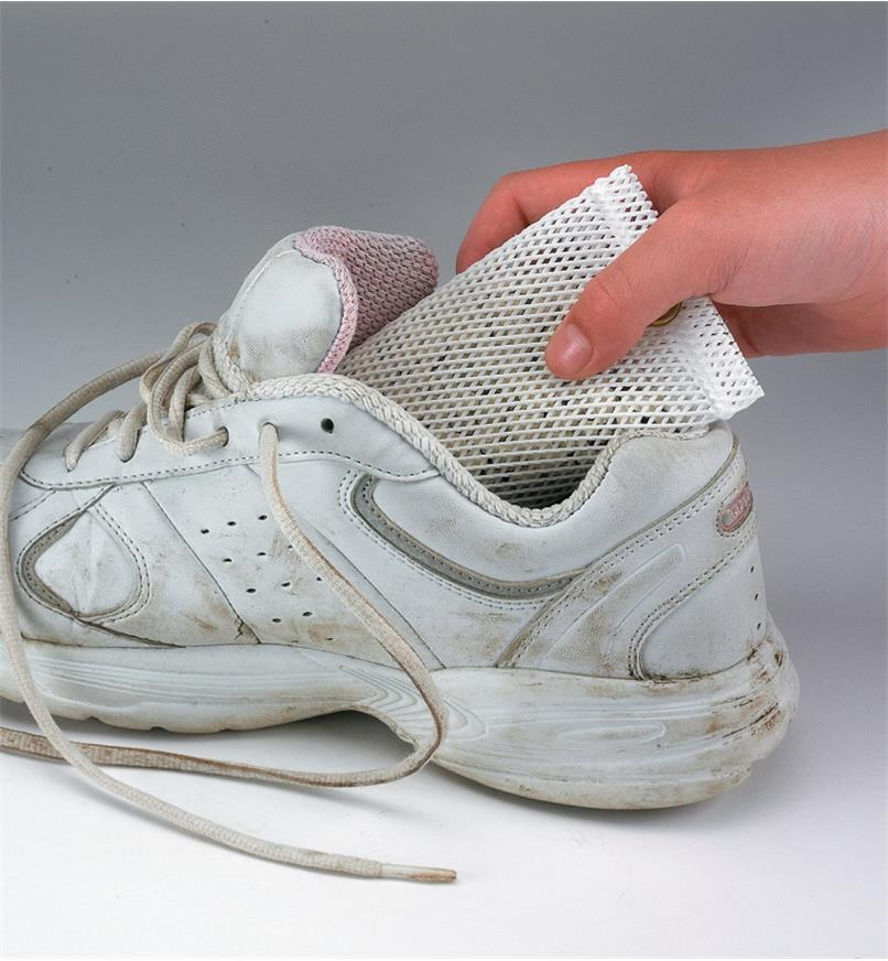 Inserting a 4 oz Deodorizer into a sneaker