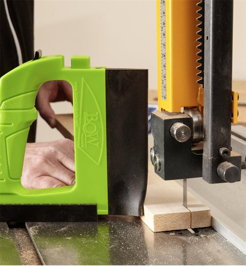 GuidePRO bandsaw guide used for sawing a short wood plank