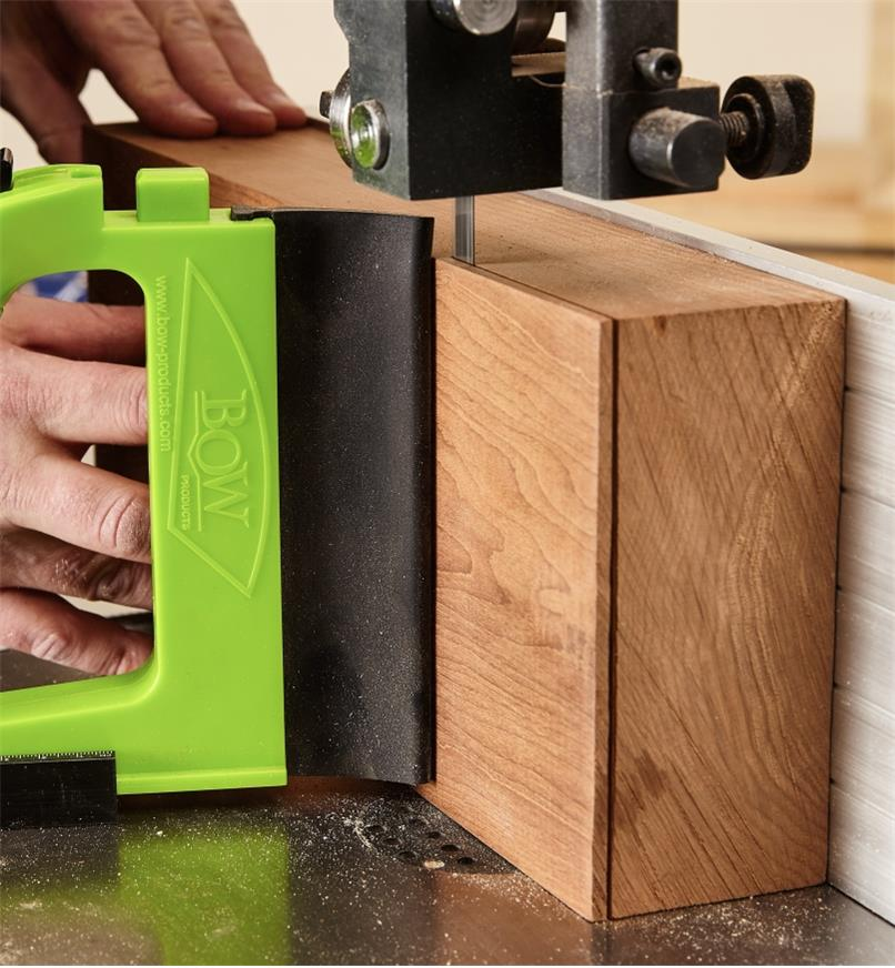 GuidePRO bandsaw guide used for resawing a tall, thick wood plank