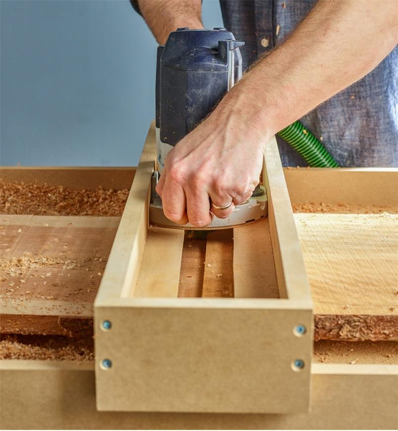 Used with a router sled, a router with a flattening bit flattens a rough wood slab to an even, workable piece