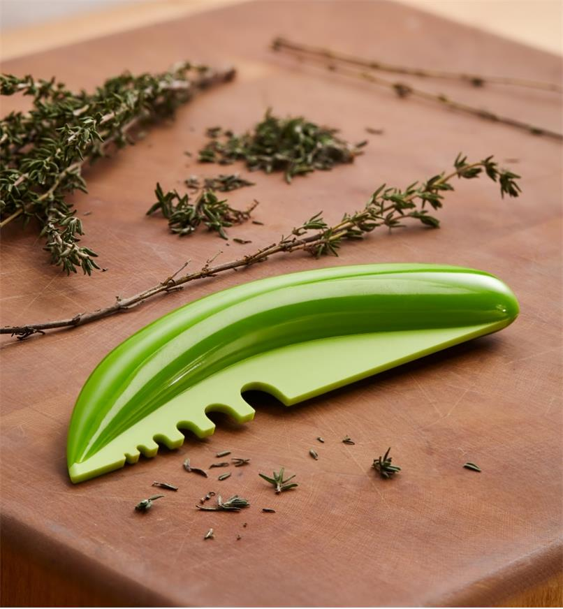 Herb Stripper with sprigs of fresh thyme