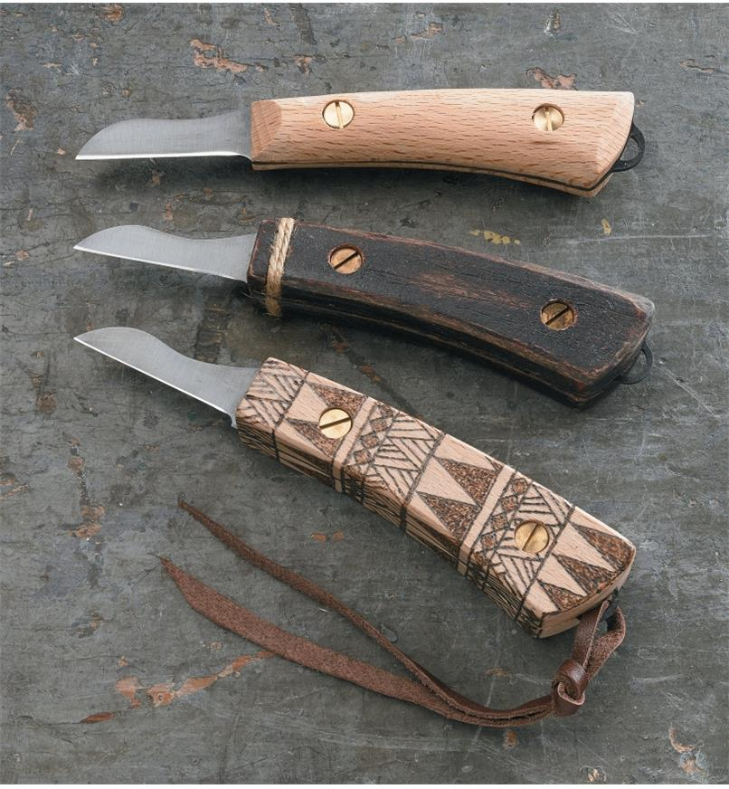 Three examples of completed carving knives with customized handles