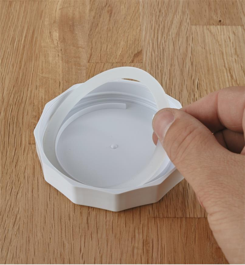 Removing the gasket from a canning jar lid