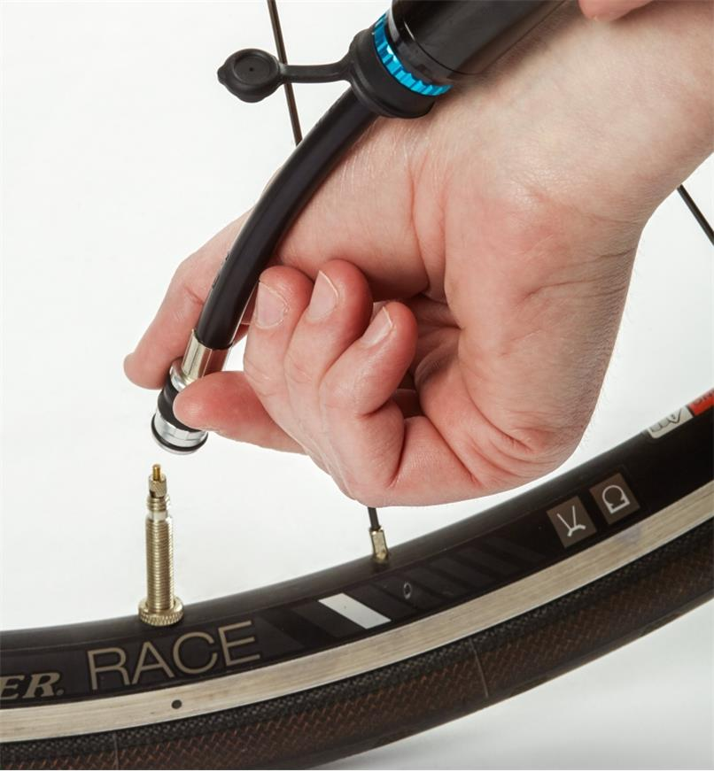 Attaching the hose fitting to a bicycle tire valve
