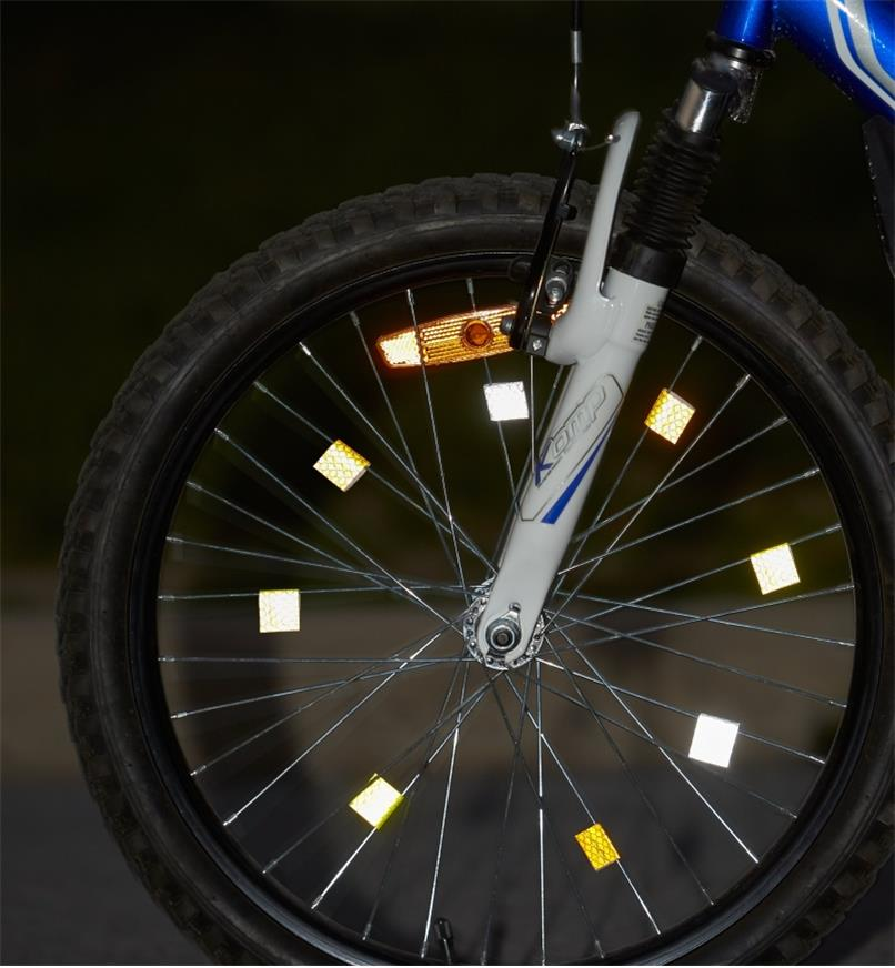 Bicycle wheel with reflective tape applied to the spokes