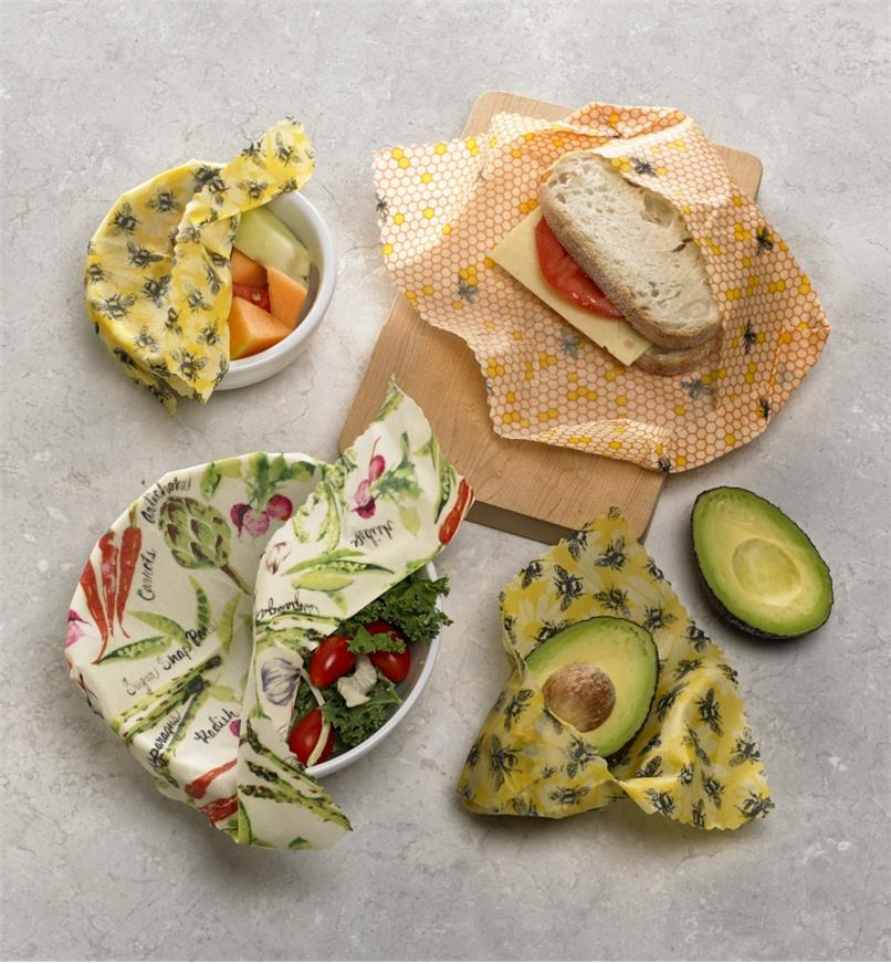 Beeswax wraps used to cover fruit, salad, an avocado and a sandwich