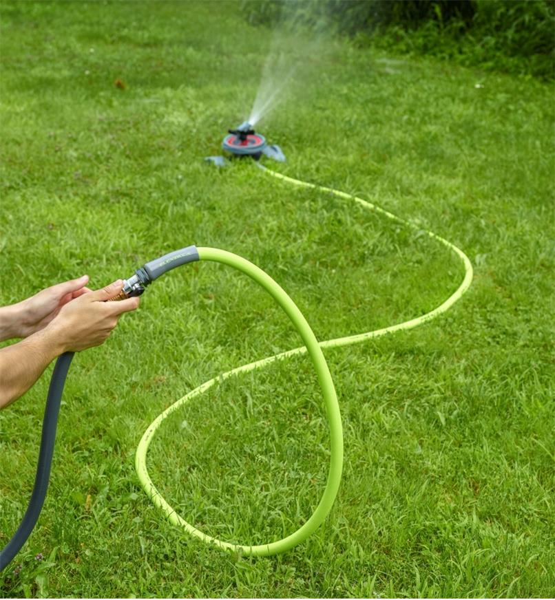 15' Flexzilla Hose connected between a sprinkler and an in-line valve and garden hose