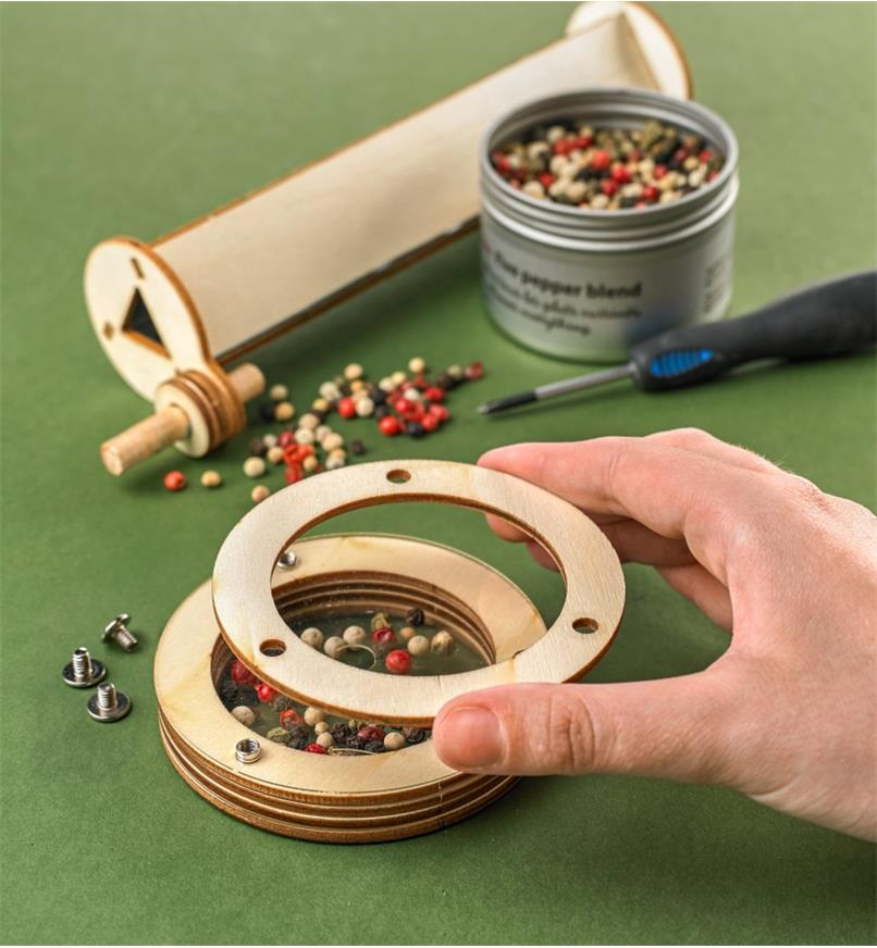Placing colored peppercorns inside the viewing case of the ever-changeable kaleidoscope