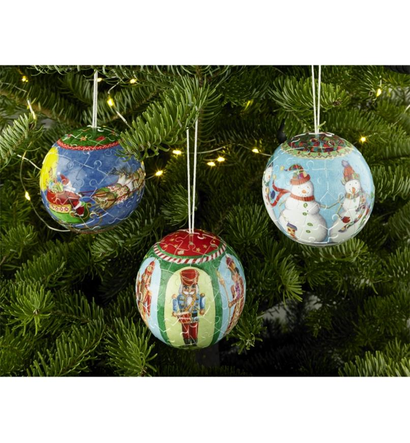 Three 3D Puzzle Christmas Ornaments hanging on a tree