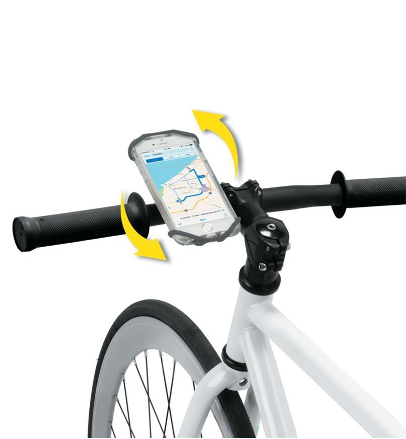Téléphone sur un support fixé au guidon d'un vélo et flèches indiquant qu'il peut pivoter sur 360°