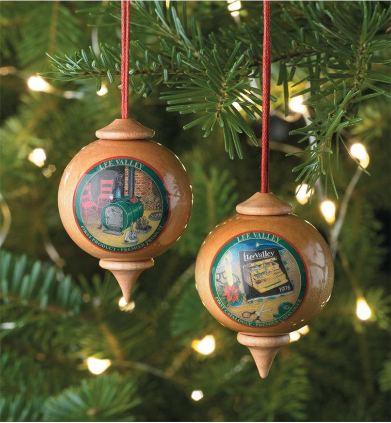 Two Lee Valley Custom Ornaments hanging on a Christmas tree