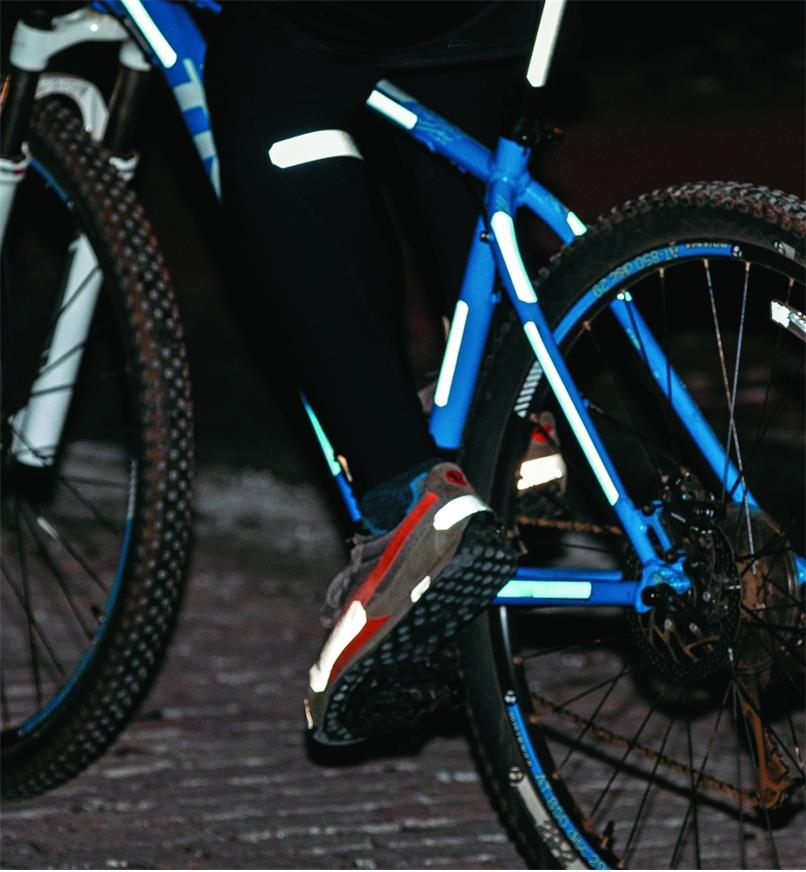 Peel-and-stick reflective strips applied to a bicycle, shoes and clothing
