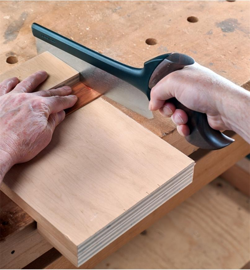 Using the Veritas Small Fine-Tooth Crosscut Saw to cut a thin piece of wood across the grain on a bench hook