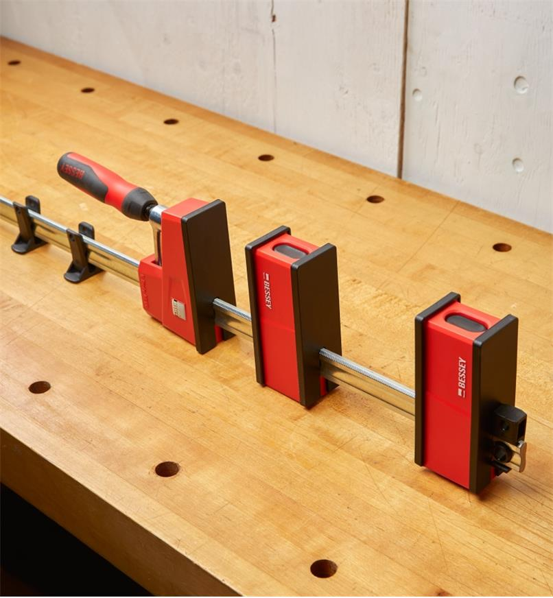 A Bessey clamp with the variable jaw positioned on its rail