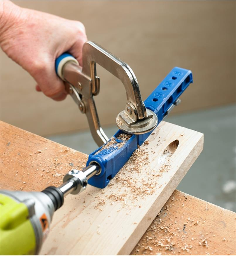 A Kreg 310 pocket-hole kit being used to drill pocket holes in a piece of wood