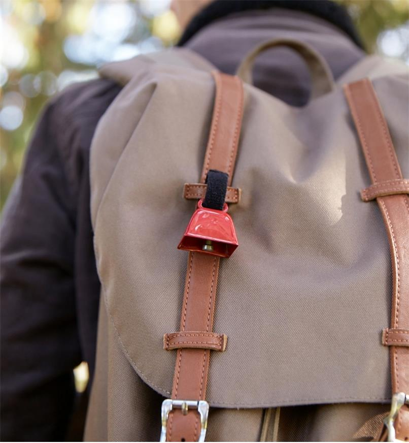 Bear bell attached to a backpack by its Velcro strap
