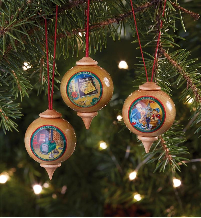 Three Lee Valley Custom Ornaments hanging on a Christmas tree