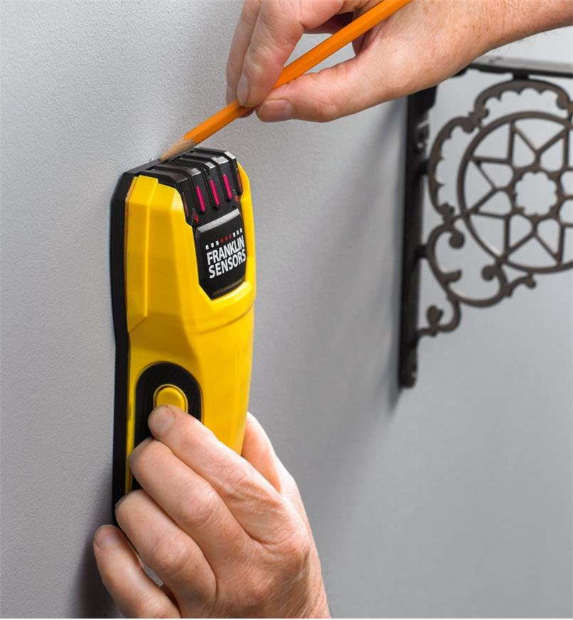 Using the Franklin M50 stud detector to locate studs for installing a wall shelf in the home