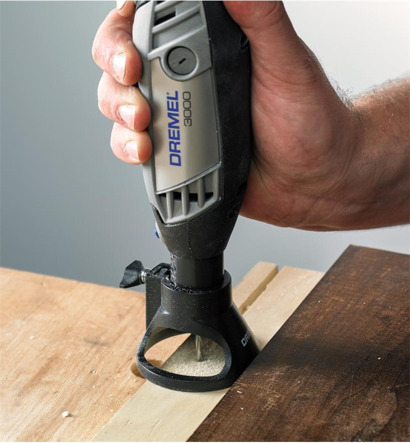 Cutting a groove in a workpiece using a Dremel 3000 rotary tool with a cutting guide attachment
