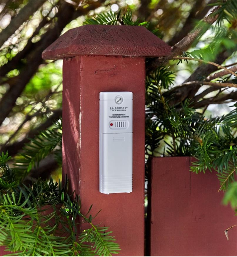 The wireless weather station's outdoor temperature/humidity sensor mounted on a post