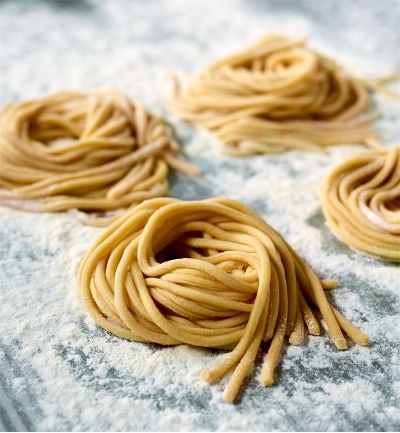 Fresh bigoli noodles made using a Marcato pasta machine with the bigoli cutter attachment