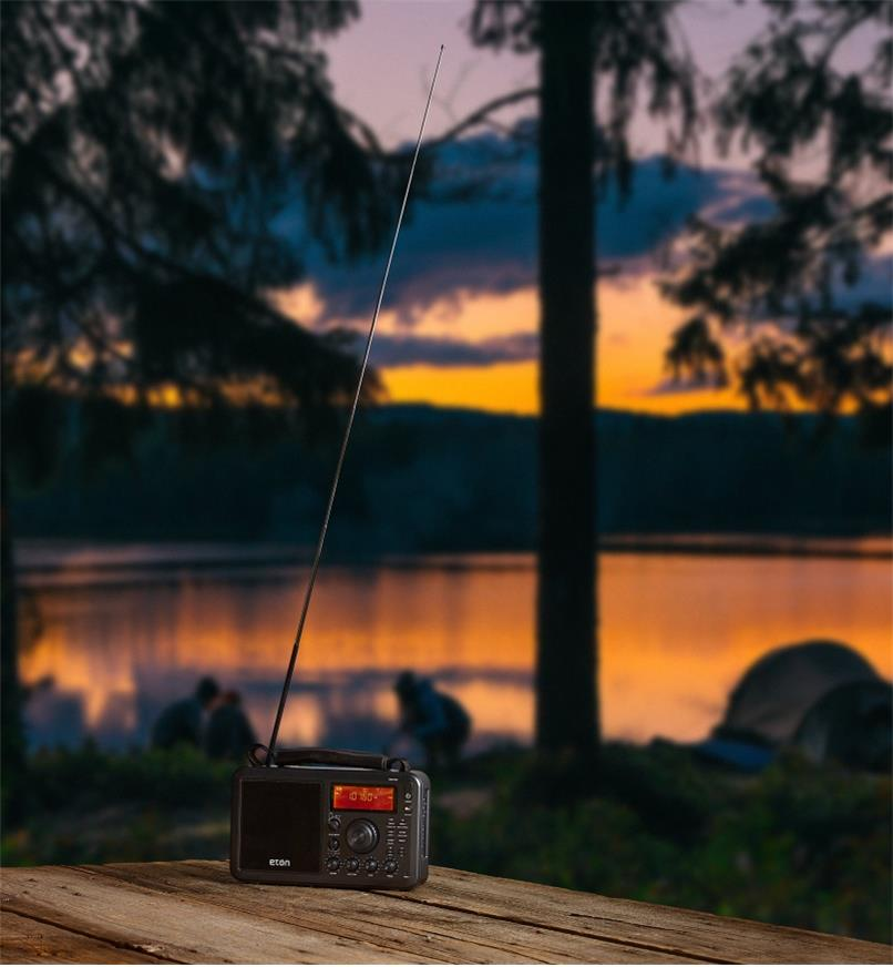 Eton AM/FM shortwave radio at a remote campsite with telescoping antenna extended for better reception