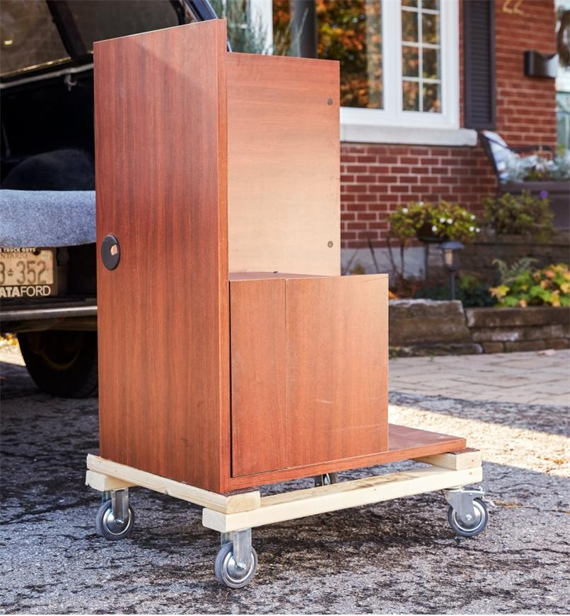 Furniture sits on a homemade dolly that has heavy-duty casters