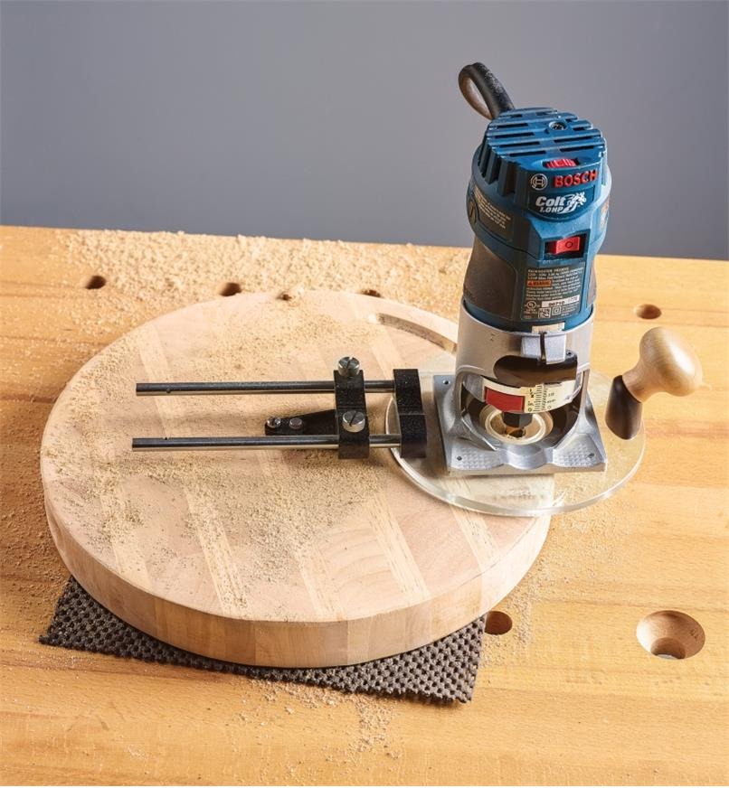 Center kit used with a compact router to rout a circle in a piece of wood