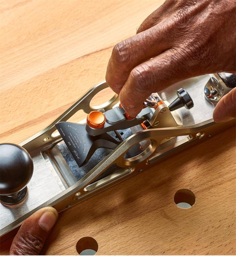 Releasing the toggle lock mechanism when changing blades on a dual-angle bench plane
