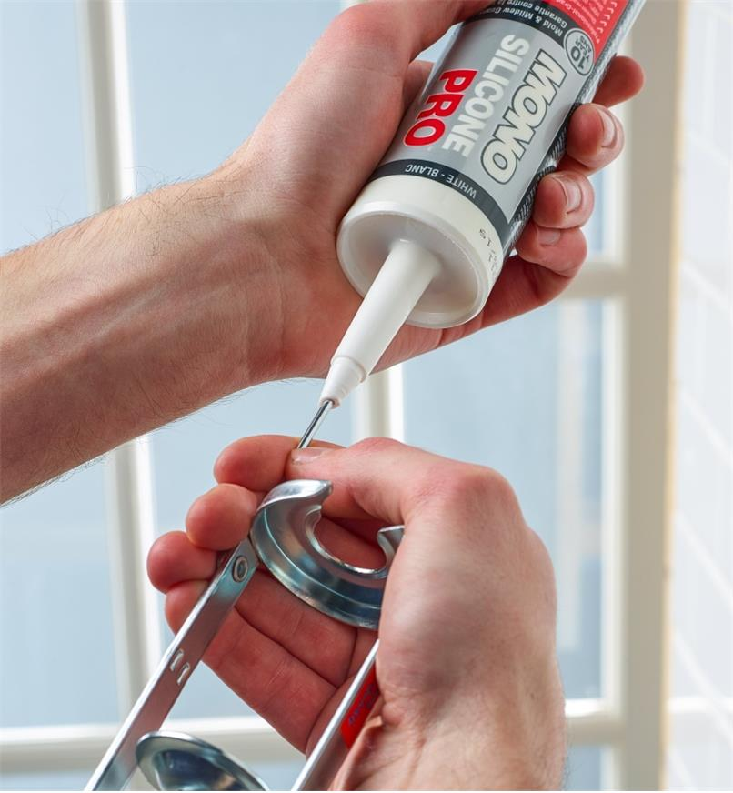 Using the seal puncture tool on a tube of caulk