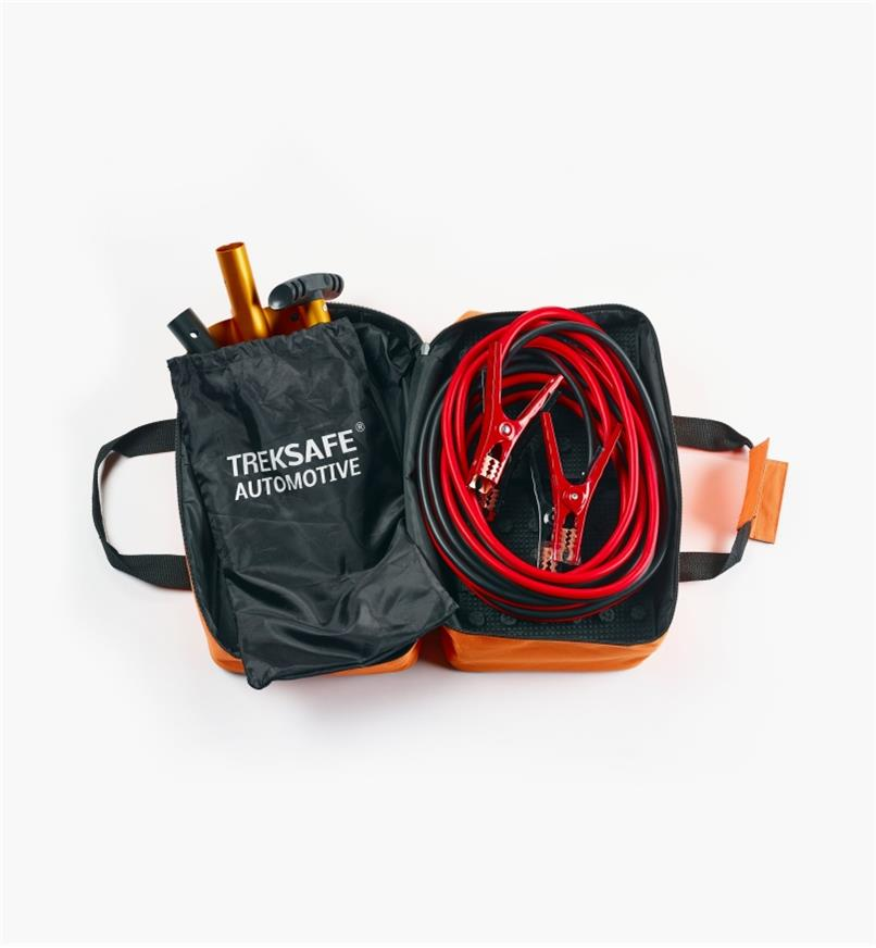 Open roadside emergency kit with collapsible shovel, booster cables and traction mats inside