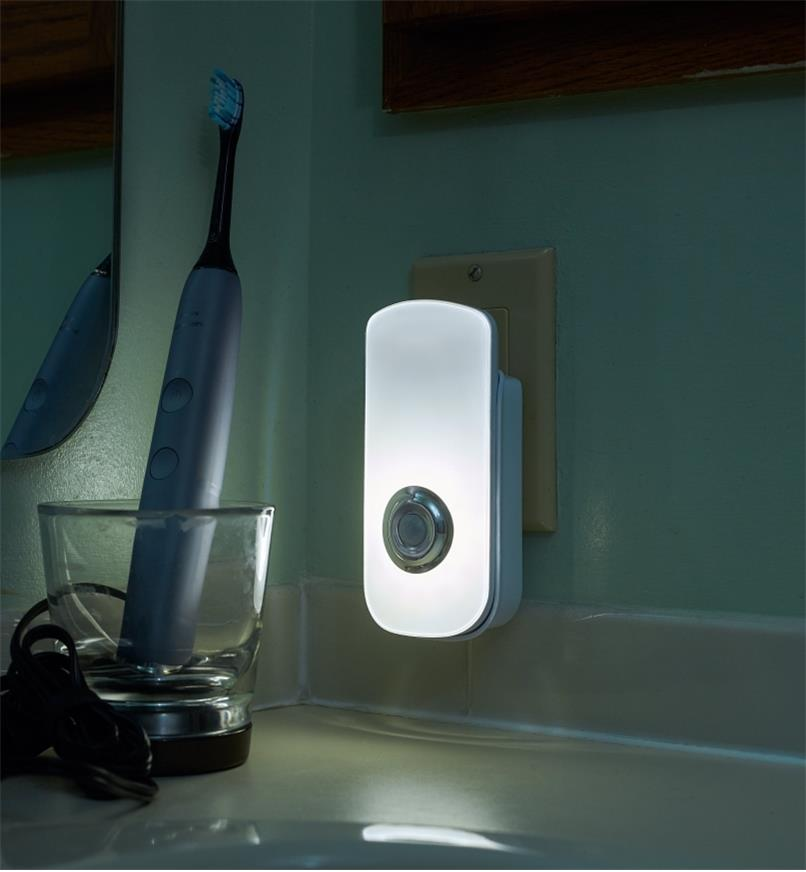 Rechargeable LED nightlight/flashlight plugged into a standard outlet