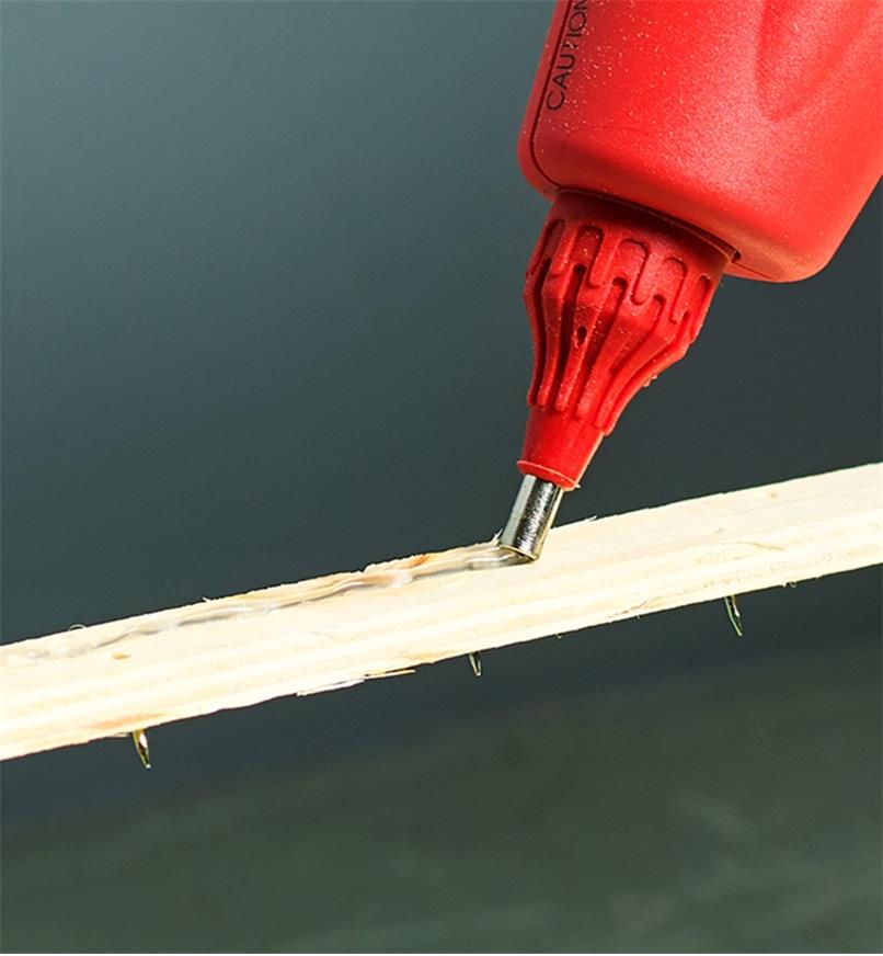 Applying a bead of glue using the regular nozzle supplied with the FastenMaster pro hot-melt gun