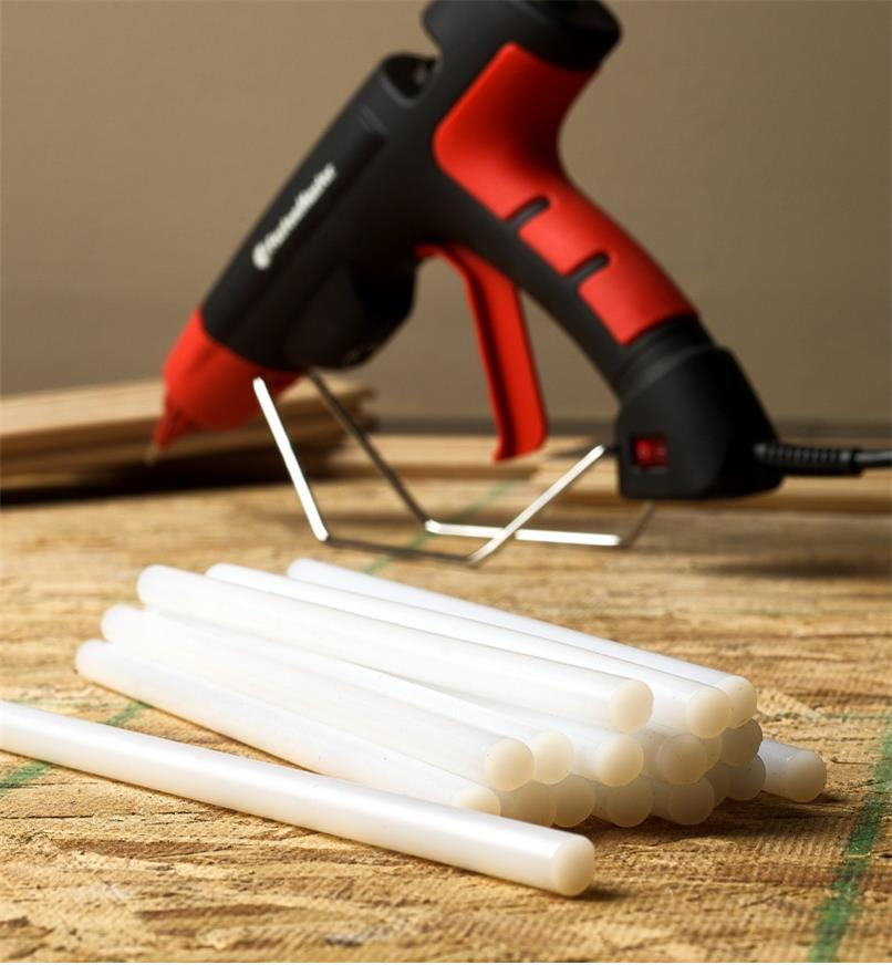 Flex 40 glue sticks and the FastenMaster pro hot-melt gun being used to install flooring