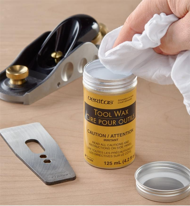 Using a soft, clean cloth to take a portion of Veritas tool wax  from its container