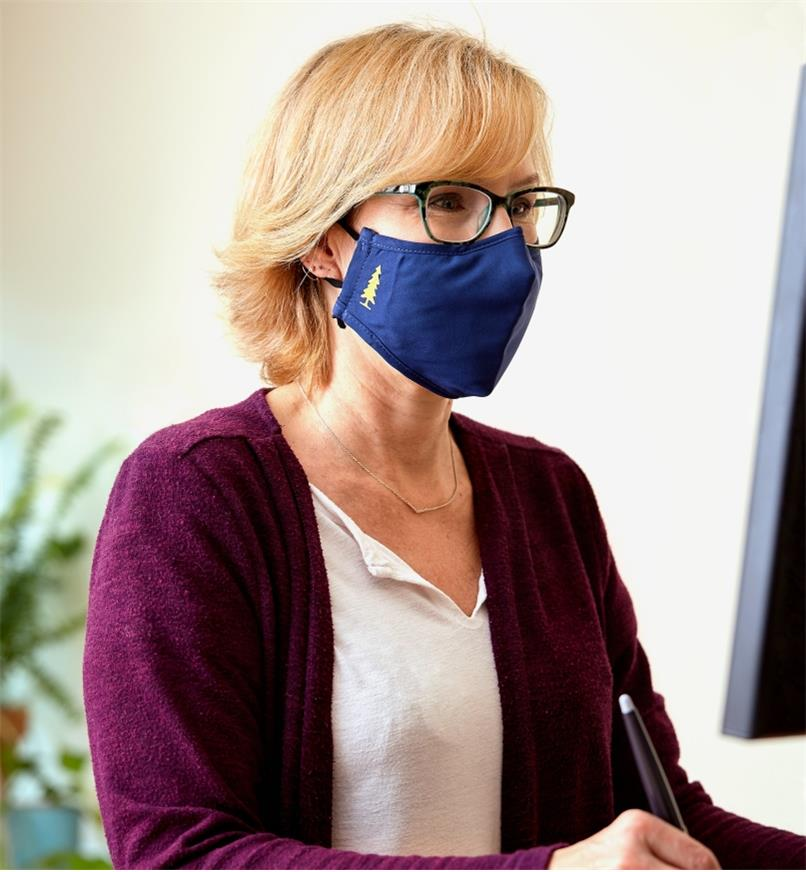 A woman wearing a Lee Valley face mask and eyeglasses