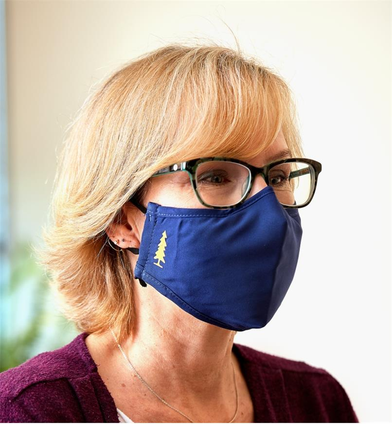A close view of a woman wearing a Lee Valley face mask and eyeglasses