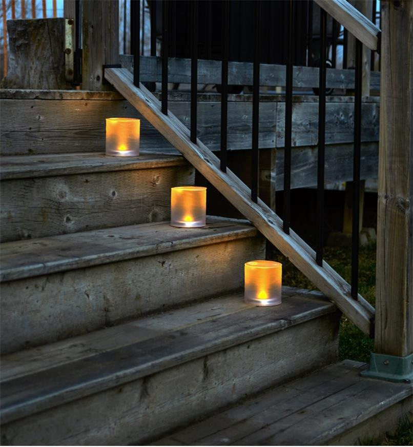 Three Inflatable Solar Candle Lanterns placed on outdoor steps